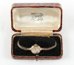 Property of a lady - a lady's Tissot 9ct gold mechanical wristwatch, on 9ct gold bracelet strap,