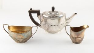 Property of a lady of title - a silver teapot and matching milk jug, with half fluted decoration,
