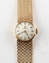 Property of a deceased estate - a lady's Omega 9ct gold cased wristwatch on Omega 9ct gold mesh