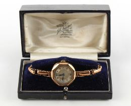 Property of a gentleman - a lady's 9ct gold cased mechanical wristwatch on elasticated 9ct gold link