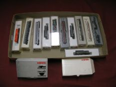 Thirteen Marklin 'Z' Gauge Pieces of Rolling Stock, including coaches and wagons, all boxed.