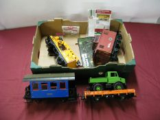 Four Loose 'G' Scale LGB Four wheel Wagons and Coaches, including crane wagon, all unboxed.