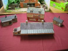 Four Kit Built Lineside Buildings, suitable for gauge 1/2, including a station, minor damages.