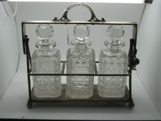 A JD&S Electroplated Three Bottle Locking Tantalus, of plain design, with three hobnail cut glass