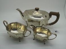 A Hallmarked Silver Three Piece Tea Set, EV, Sheffield 1939, each of plain elongated octagonal form,
