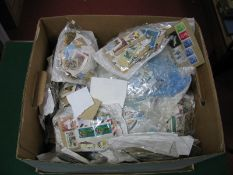A Large Carton of GB and World Used Stamps, in packets and on album leaves, many thousands.
