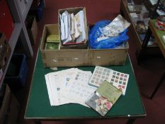 A Large Carton of GB and World Stamps, mainly used both some mint GB in small boxes, packets,