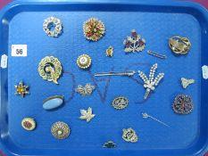 "An Arts & Crafts ""Astra"" Ceramic Panel Brooch, oval collet set, a 9ct gold bar brooch (1.5grams),"