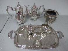 An Oneida USA Plated Four Piece Teaset, together with a decorative twin handled plated tray and a