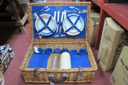 Optima England Picnic Basket, plates, knives, forks, flask, coffee mugs, etc:- in a wicket basket.