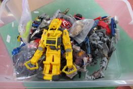 A Quantity of Transformers Style Plastic and Diecast Vehicles, Creatures, Spacecraft, all loose.