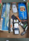 A Japanese Tinplate Chevrolet Police Car, playworn diecast, a started Airfix kit, among other items,