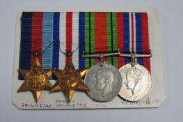 A WWII Set of Four Medals, comprising 1939-45 Star/France Germany Star/War Medal/Defence Medal,