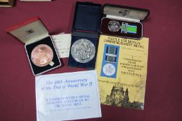 A Royal Mint Bronze 40th Anniversary End of WWII Medal, case, a Battle of Britain Commemorative