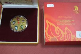 A Beijing Olympics 2008 Flower Shaped Mascots Commemorative Medallion, accompanied by literature,