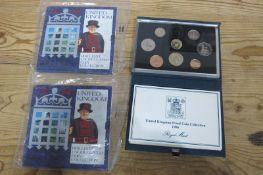 Two 1994 Royal Mint United Kingdom Brilliant Uncirculated Coin Collection, with D-Day Fifty Pence,