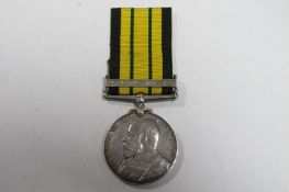 An Edward VII Africa General Service Medal, with Somaliland 1908-10 clasp, rim badly damaged - may