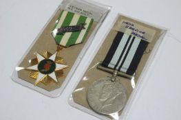 A George VI India Service Medal and a Vietnam Campaign Medal.