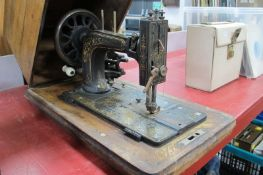 Frister and Rossmann of Berlin Sewing Machine, in inlaid flat top case.