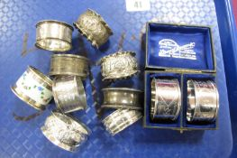 A Collection of Eleven Hallmarked Silver Napkin Rings, (some marks rubbed/indistinct) including pair