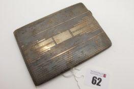 A Hallmarked Silver Cigarette Case, Birmingham 1933, of slim rectangular form, allover engine
