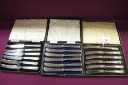Three Sets of Six Hallmarked Silver Handled Tea Knives, two sets with ribbon and reed decoration, in