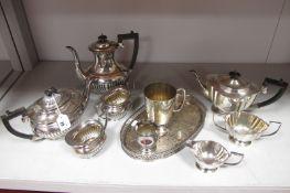 A Plated Four Piece Tea Set, of oval semi reeded form, together with a plated three piece tea set,