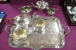 An Elkington & Co Plated Three Piece Tea Set, each of oval semi reeded form; together with an Art