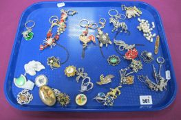 A Selection of Vintage and Later Costume Brooches, including floral inspired; together with seven