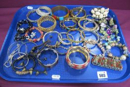 A Selection of Modern Bracelets and Bangles, including diamante, sliding charm style, gilt coloured,