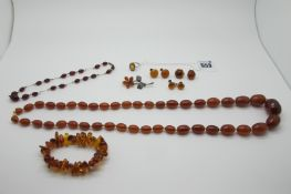 A Cherry Amber Coloured Faceted Bead and Wire Necklace, 36cm long; together with an amber coloured