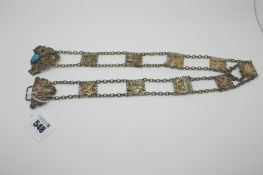 A Vintage Ladies Belt, of Egyptian design, composed of nine square decorative panels, on chain