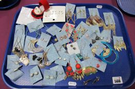 A Variety of Modern Earrings, including ornate drops, claw set earstuds, etc:- One Tray