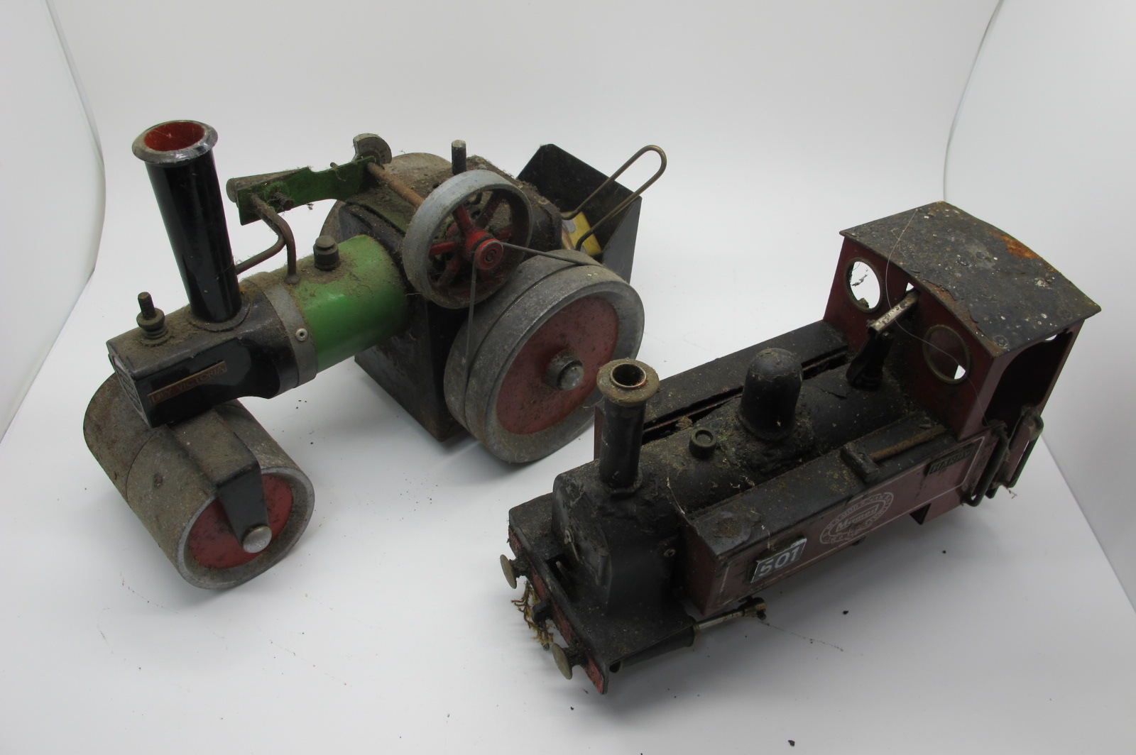 A Mamod SL3 0-4-0 Live Steam Locomotive and a Mamod SR1 Steam Roller, both playworn, modified