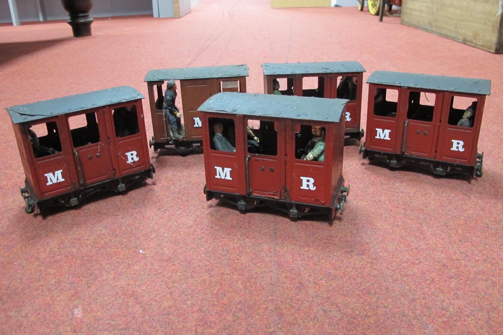 Five Mamod Live Steam Railway Four Wheel Coaches, playworn, damaged, unassociated passengers.