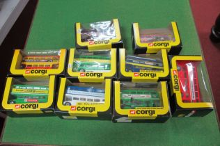 Nine 1980's Corgi Routemasters, all boxed including 'Pop on This Bus to HMV Shop'.