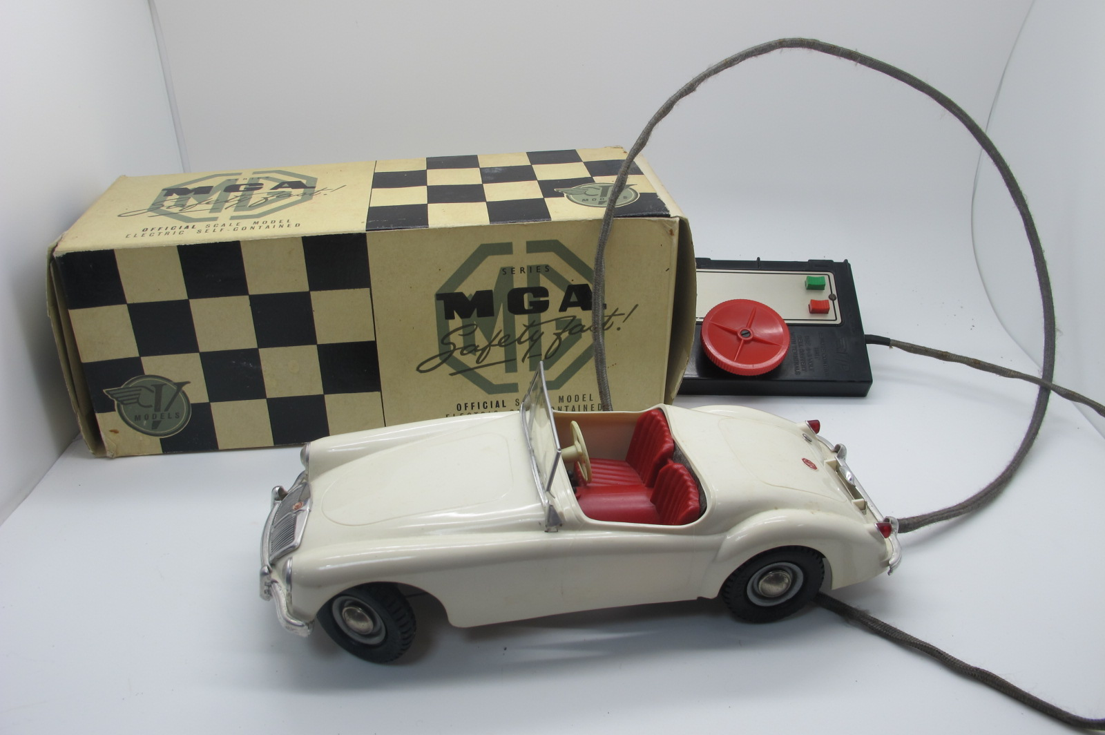 A Victory Industries Remote Control MGA, finished in white, appears complete but windscreen damaged,