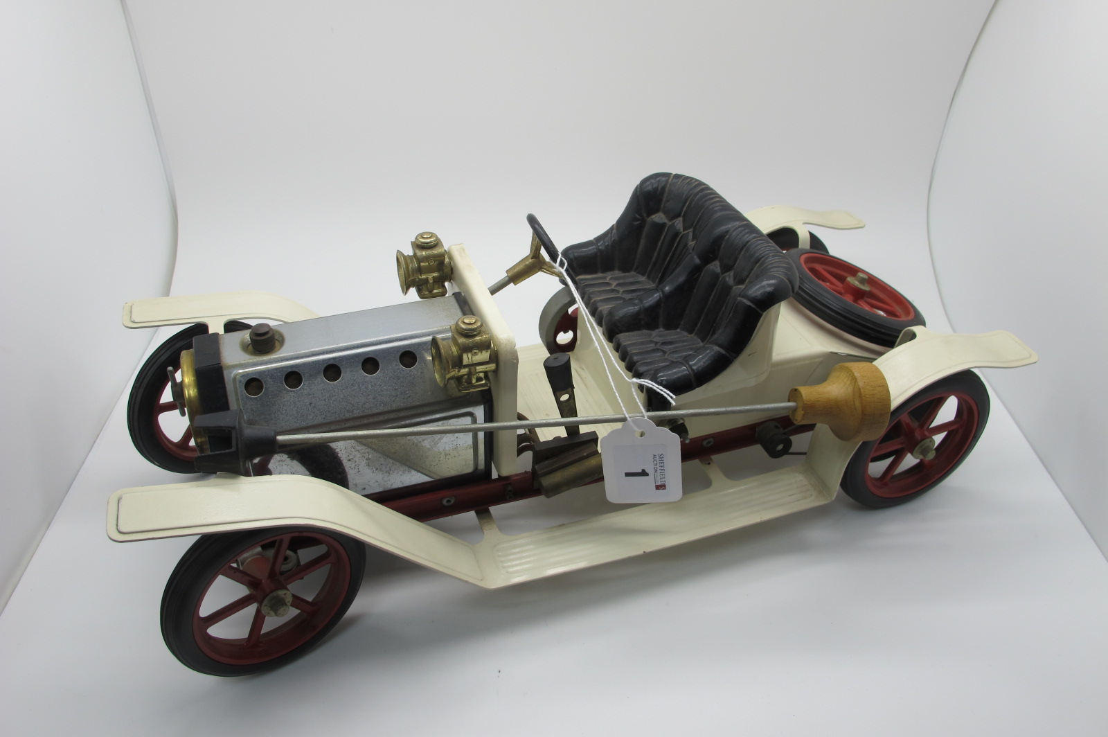 A Mamod Steam Car, appears complete including burnel and steering rod, appears unsteamed, unboxed.