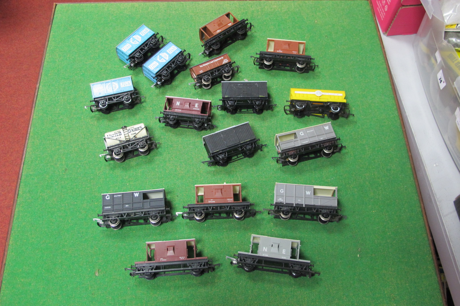 Over Fifteen 'OO' Scale Four Wheel Railway Wagons, by Hornby and others, all playworn.