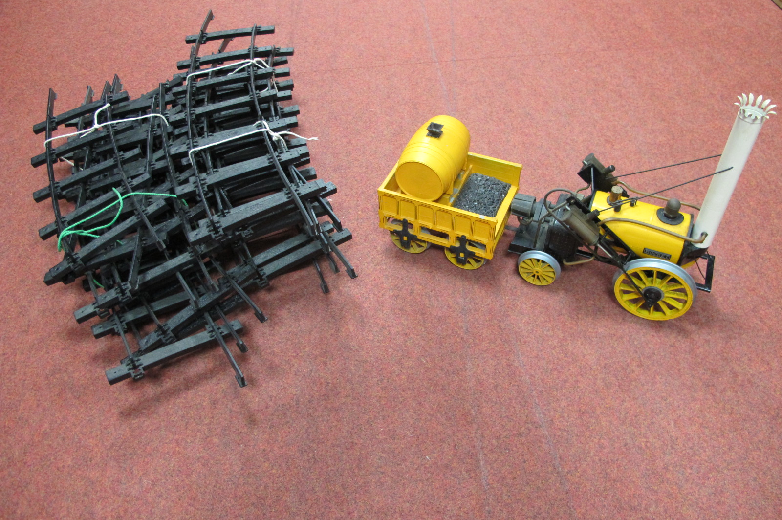 """A Hornby 3½"""" Gauge Live Steam 'Stephenson Rocket, signs of use and wear with track, all unboxed."""