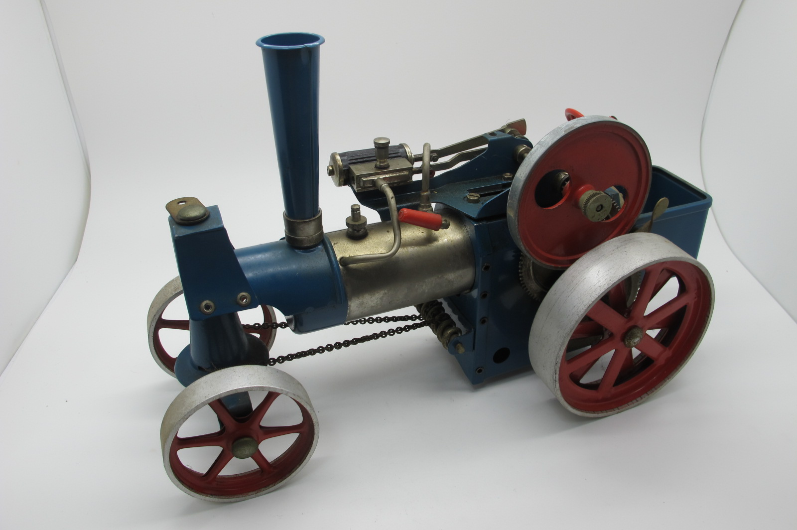 A Wilesco Live Steam Traction Engine, appears complete, including burner, has been steamed,