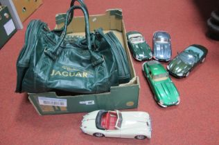 Five 1/18th Scale Model Jaguars, by Burago and others, plus a Jaguar branded bag.