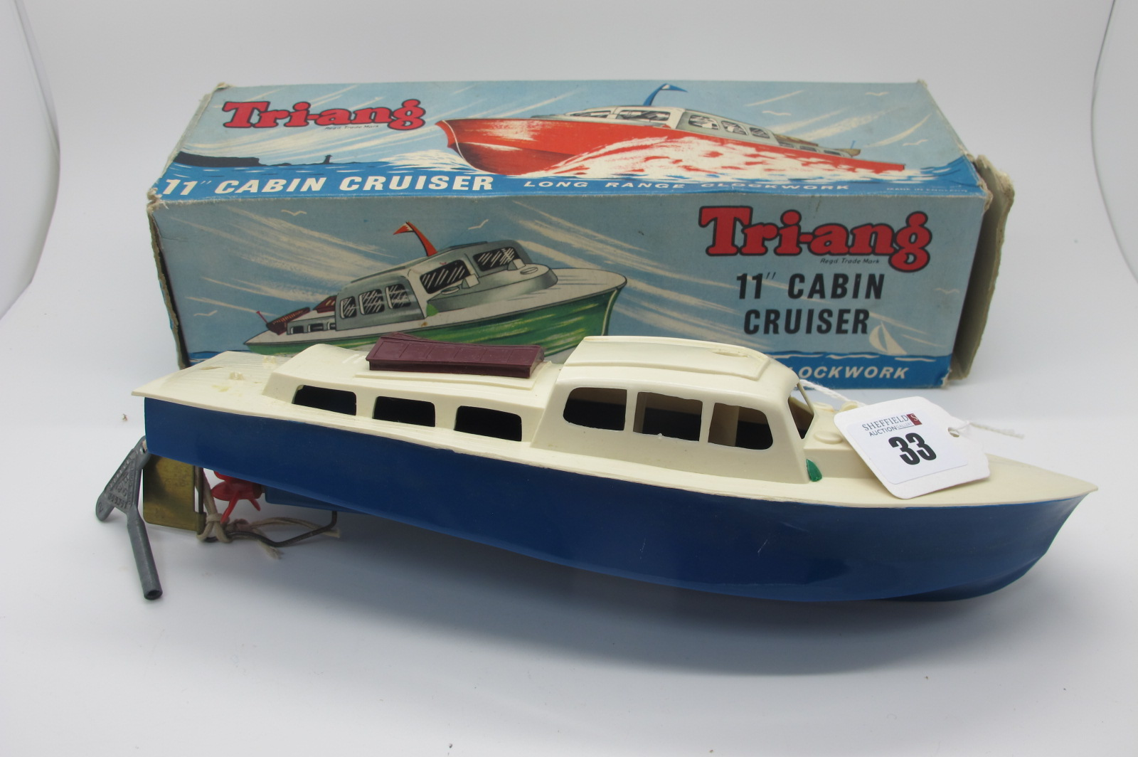 "A Tri-ang 11"" Cabin Cruiser, clockwork with key and boxed."