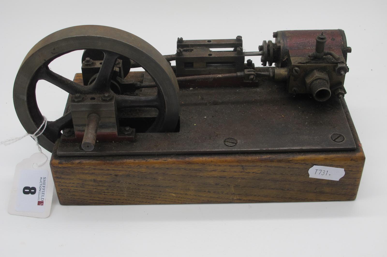 "A Horizontal Single Cylinder Steam Engine, 4½"" diameter flywheel, 1"" draw all on a wooden plinth,"