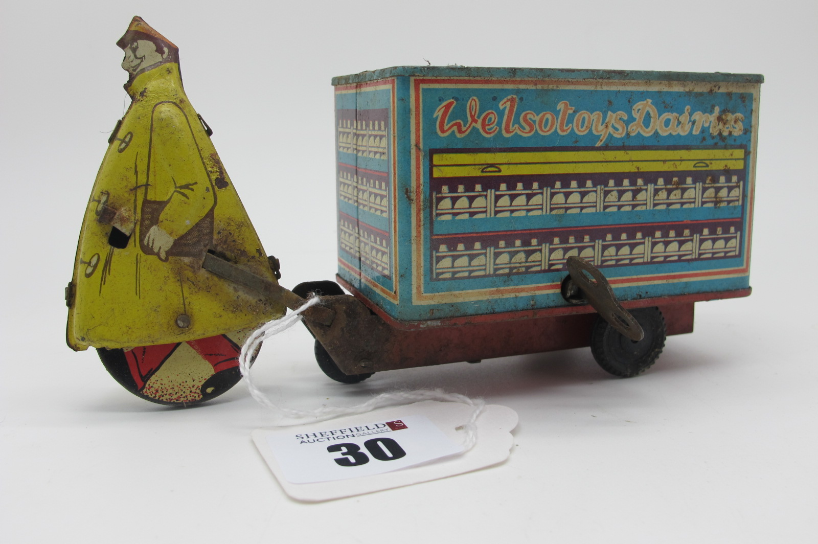 A Mid XX Century Tinplate/Clockwork 'Welsotoys Dairies' Milk Cart, some rusting and wear to places.