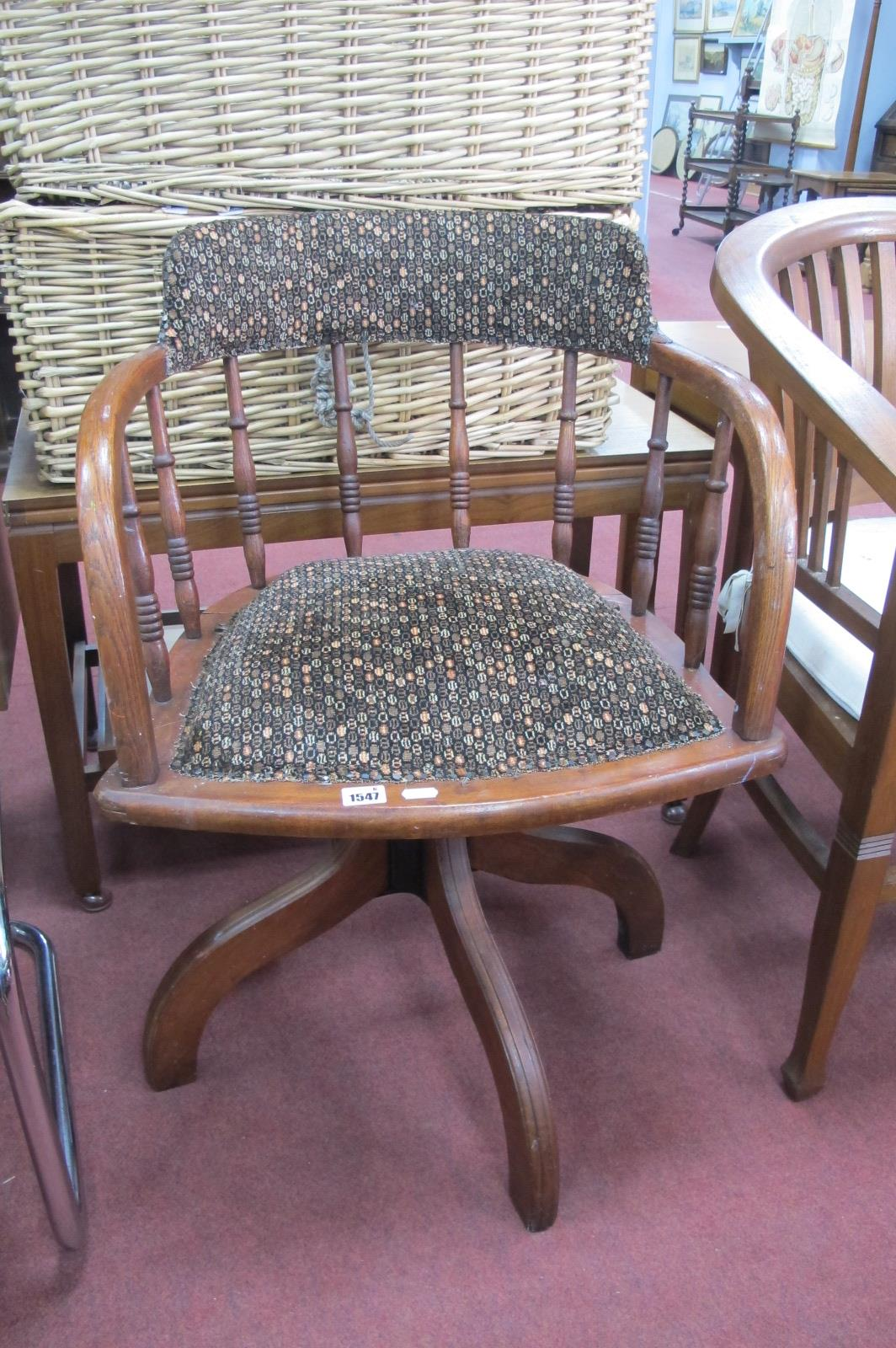 An Early XX Century Oak Revolving Office Chair, with adjustable height mechanism.