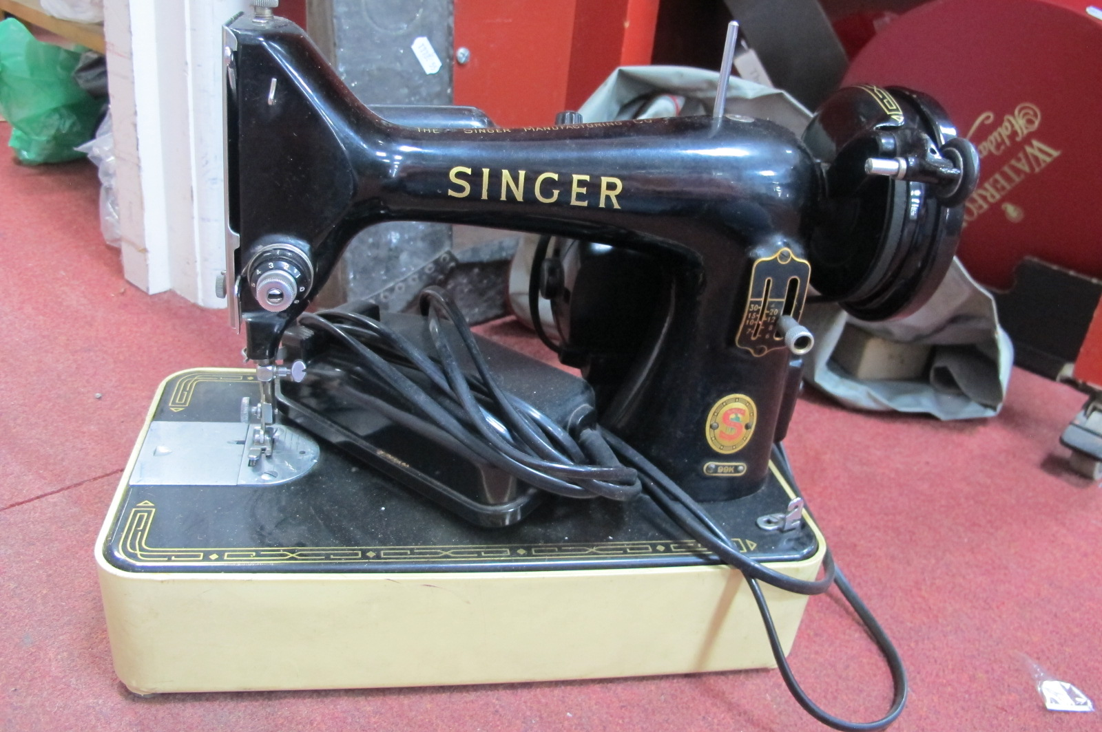 A Singer Sewing Machine. Beaten brass covered fender in the arts and crafts manner. (2)