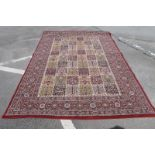 A Middle Eastern Carpet, with nine banks of six rectangular panels, allover floral decoration, on