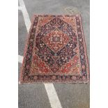Middle Eastern Wool Rug, all over floral decoration in many colours, on rust red ground 154 x