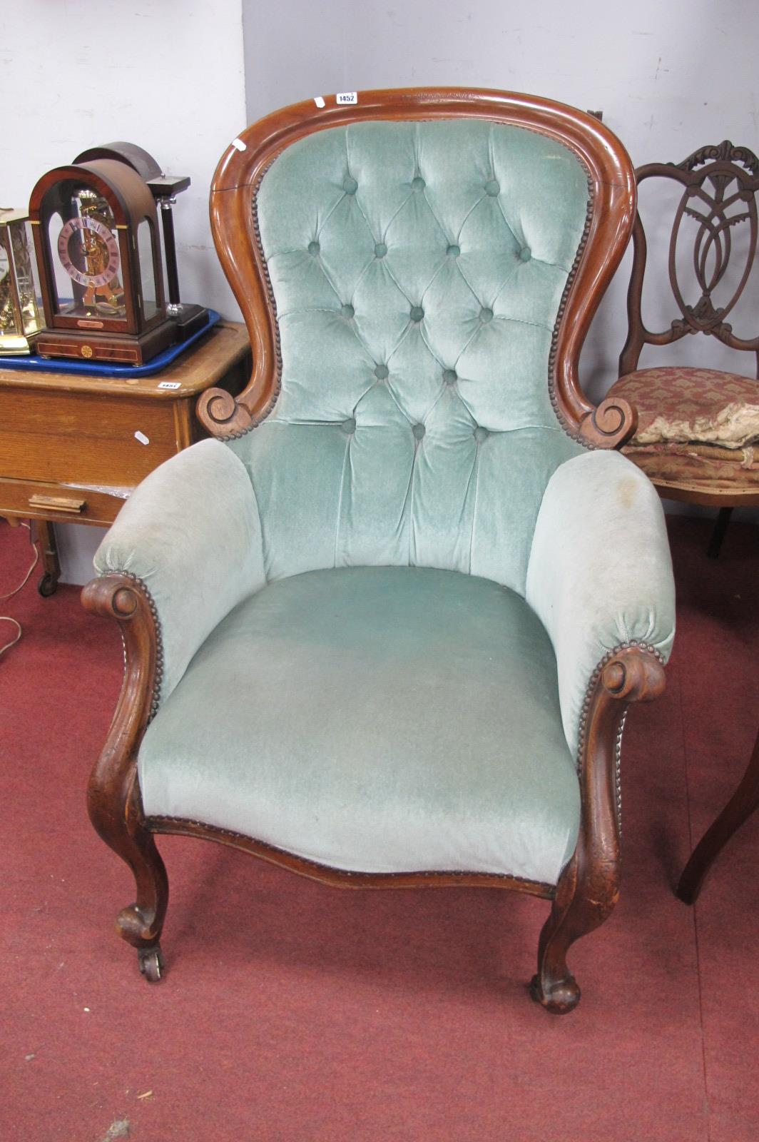 A XIX Century Mahogany Framed Arm Chair, with balloon back, scrolled hand rests, upholstered in a